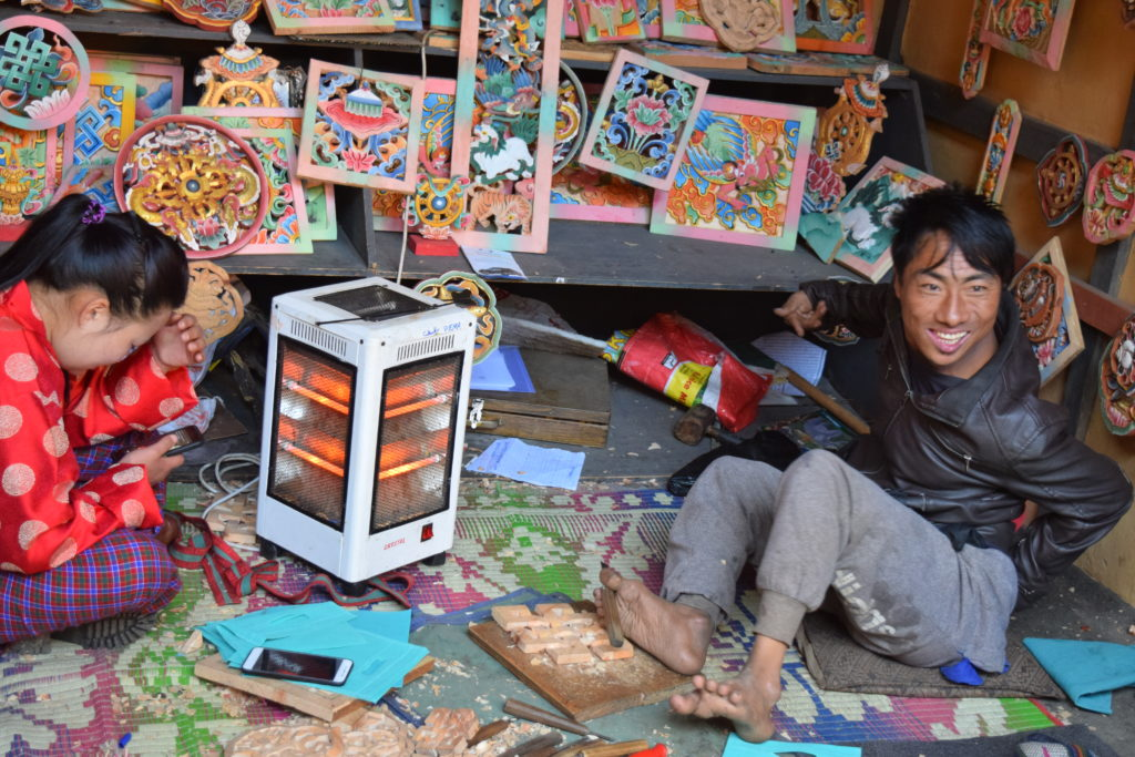 Pema and his art work at Simply Bhutan